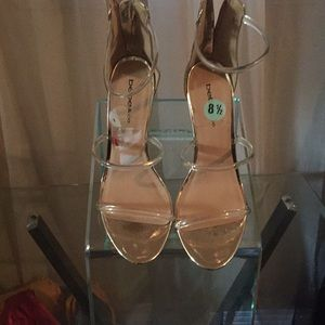 Bebe  clear and gold heels